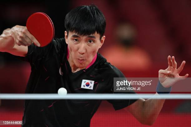 South Korea's Lee Sang-su competes against China's Ma Long during their men's team semifinal table tennis match at the Tokyo Metropolitan Gymnasium...