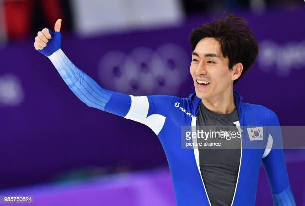 South Korea's Lee SeungHoon celebrates after the men's 5000m speed skating event on day two of the Pyeongchang 2018 Winter Olympics Games at the...