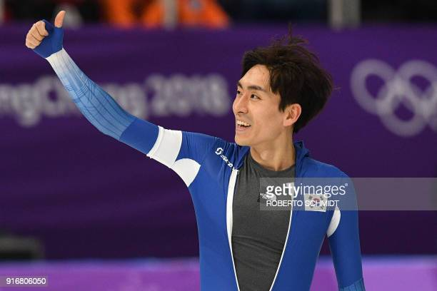 South Korea's Lee Seung-Hoon celebrates after the men's 5,000m speed skating event during the Pyeongchang 2018 Winter Olympic Games at the Gangneung...