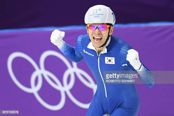 TOPSHOT South Korea's Lee SeungHoon celebrates his gold medal win in the men's mass start final speed skating event during the Pyeongchang 2018...