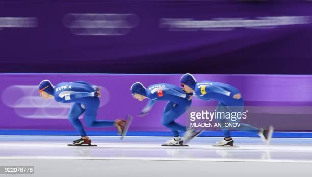 TOPSHOT South Korea's Lee SeungHoon South Korea's Chung Jaewon and South Korea's Kim Min Seok compete in the men's team pursuit final A speed skating...