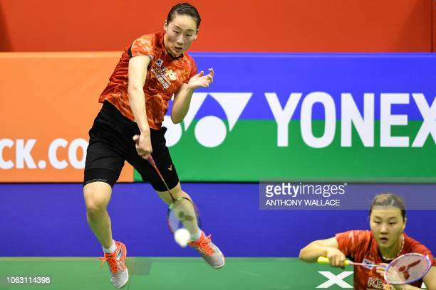 South Korea's Lee Sohee and Shin Seungchan hit a return against Japan's Yuki Fukushima and Sayaka Hirota during their women's doubles final at the...