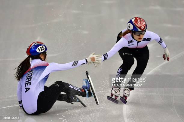 South Korea's Lee Yubin hands the relay to teammate Choi Minjeong in the women's 3,000m relay short track speed skating heat event during the...