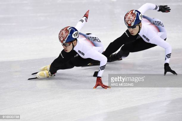 South Korea's Lim Hyojun and South Korea's Hwang Daeheon take part in the men's 1,500m short track speed skating semi-final event during the...