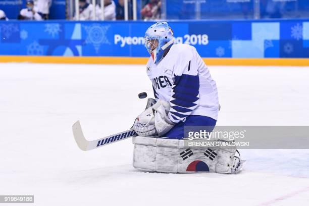 South Korea's Matt Dalton blocks a shot in the men's preliminary round ice hockey match between Canada and South Korea during the Pyeongchang 2018...