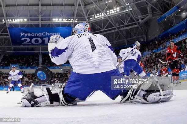 TOPSHOT South Korea's Matt Dalton lets in a goal by Canada's Christian Thomas in the men's preliminary round ice hockey match between Canada and...