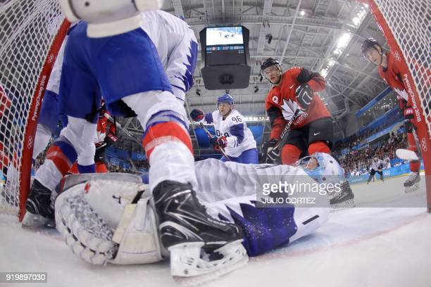 South Korea's Matt Dalton lies on the ice to block the puck in the men's preliminary round ice hockey match between Canada and South Korea during the...