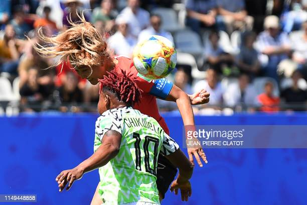 South Korea's midfielder Cho Sohyun vies for the ball with Nigeria's midfielder Rita Chikwelu during the France 2019 Women's World Cup Group A...