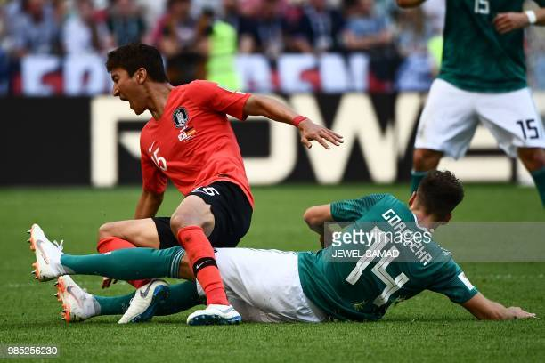 South Korea's midfielder Jung Wooyoung vies for the ball with Germany's midfielder Leon Goretzka during the Russia 2018 World Cup Group F football...