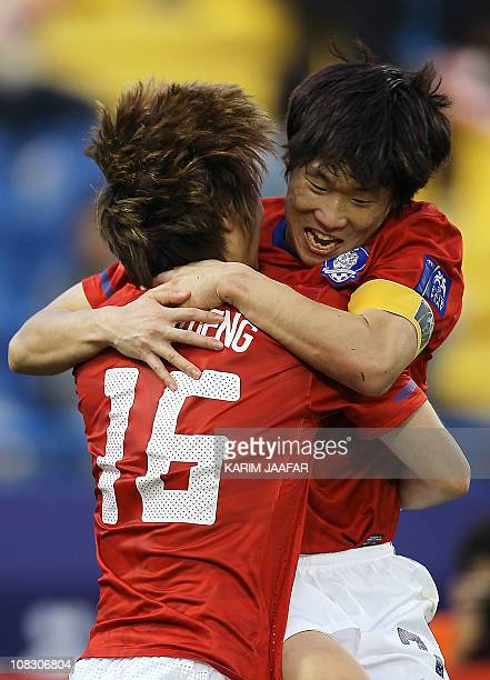 South Korea's midfielder Ki Sung-Yueng celebrates with midfielder Park Ji-Sung after scoring his team's opening goal against Japan during their 2011...