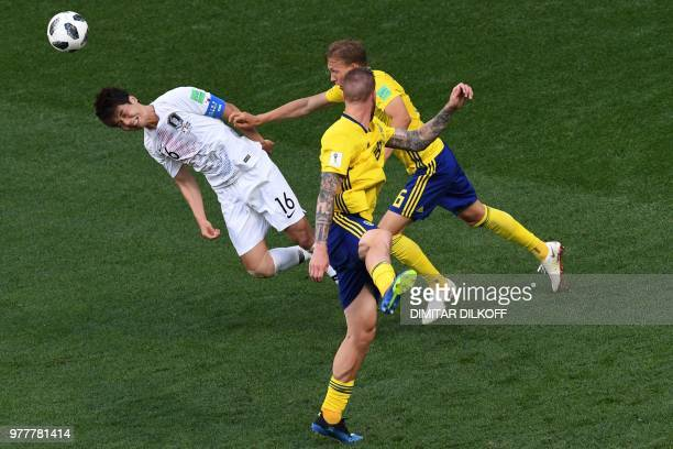 TOPSHOT South Korea's midfielder Ki Sungyueng heads the ball during the Russia 2018 World Cup Group F football match between Sweden and South Korea...