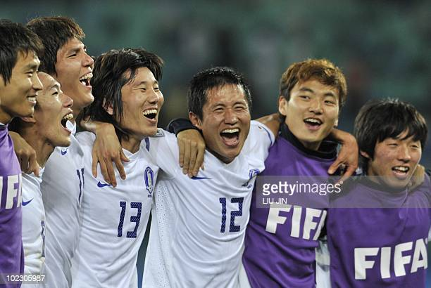 South Korea's midfielder Kim JaeSung and South Korea's defender Lee YoungPyo react at the end of their Group B first round 2010 World Cup football...