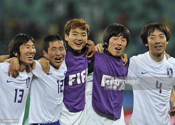 South Korea's midfielder Kim JaeSung South Korea's defender Lee YoungPyo and South Korea's defender Cho YongHyung celebrate after their Group B first...
