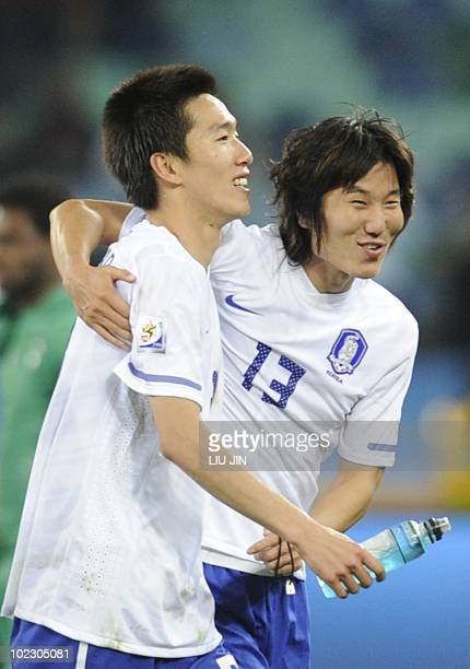 South Korea's midfielder Kim JungWoo and South Korea's midfielder Kim JaeSung celebrate after their Group B first round 2010 World Cup football match...