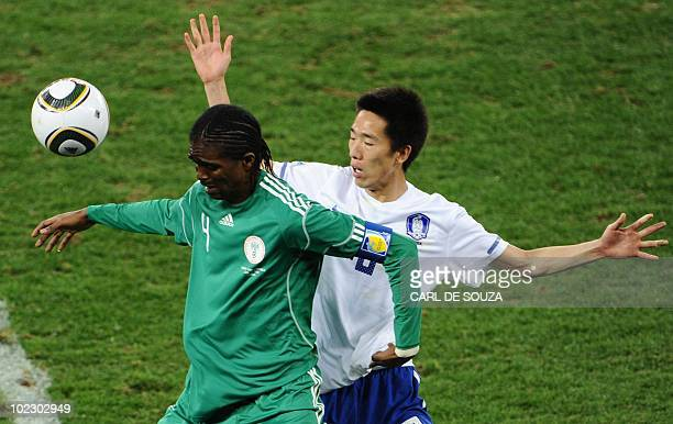 South Korea's midfielder Kim JungWoo challenges Nigeria's midfielder Nwankwo Kanu during the Group B first round 2010 World Cup football match...
