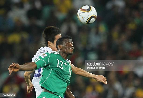 South Korea's midfielder Kim JungWoo clashes with Nigeria's midfielder Yussuf Ayila during the Group B first round 2010 World Cup football match...