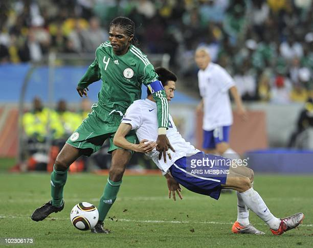 South Korea's midfielder Kim JungWoo clashes with Nigeria's midfielder Nwankwo Kanu during the Group B first round 2010 World Cup football match...