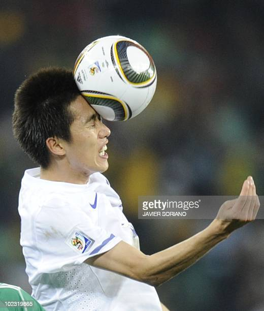 South Korea's midfielder Kim JungWoo heads the ball during the Group B first round 2010 World Cup football match between Nigeria and South Korea on...