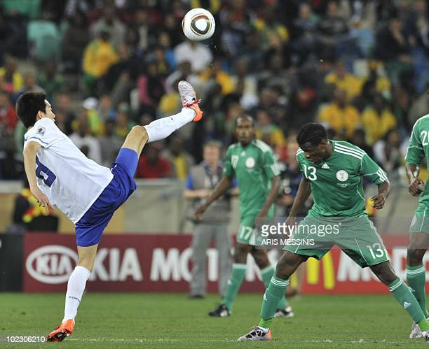 South Korea's midfielder Kim JungWoo kicks the ball as Nigeria's midfielder Yussuf Ayila defends during the Group B first round 2010 World Cup...