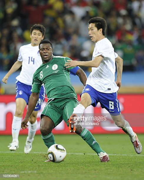 South Korea's midfielder Kim JungWoo vies with Nigeria's striker Yakubu Aiyegbeni during their Group B first round 2010 World Cup football match on...