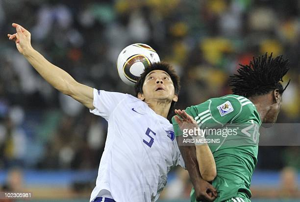 South Korea's midfielder Kim NamIl clashes with Nigeria's midfielder Dickson Etuhu during the Group B first round 2010 World Cup football match...