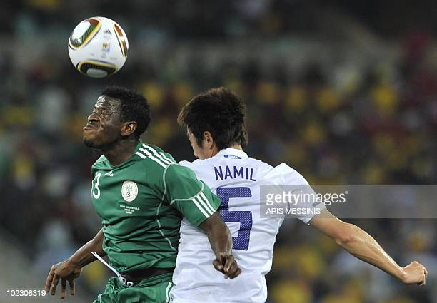 South Korea's midfielder Kim NamIl clashes with Nigeria's midfielder Yussuf Ayila during the Group B first round 2010 World Cup football match...