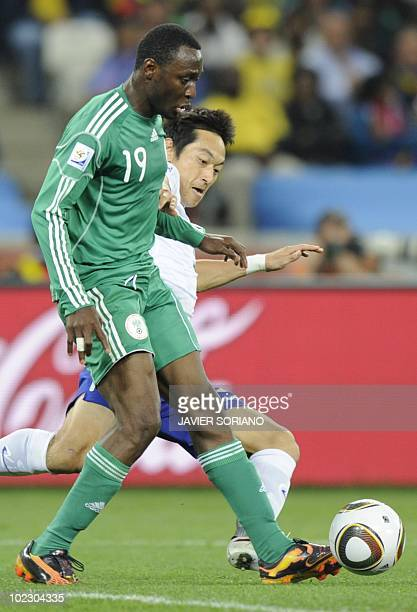 South Korea's midfielder Kim NamIl vies with Nigeria's striker Chinedu Obasi during their Group B first round 2010 World Cup football match on June...
