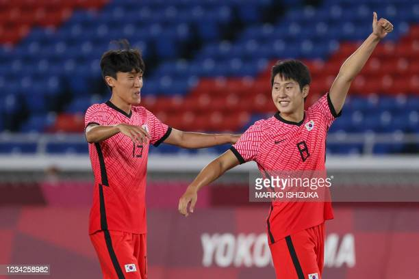 South Korea's midfielder Lee Kang-in celebrates after scoring their sixth goal during the Tokyo 2020 Olympic Games men's group B first round football...