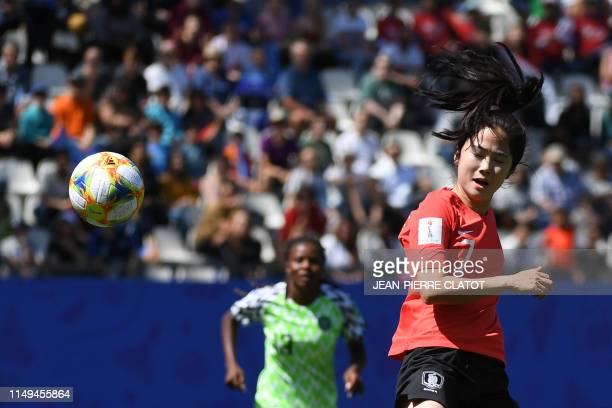 South Korea's midfielder Lee Mina heads the ball during the France 2019 Women's World Cup Group A football match between Nigeria and South Korea on...