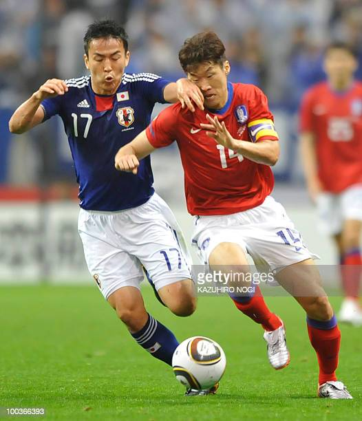 South Korea's midfielder Park Ji Sung and Japan's Makoto Hasebe fight for the ball during their international friendly football match at Saitama...