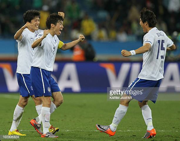 South Korea's midfielder Park JiSung and South Korea's defender Kim DongJin celebrate after their Group B first round 2010 World Cup football match...