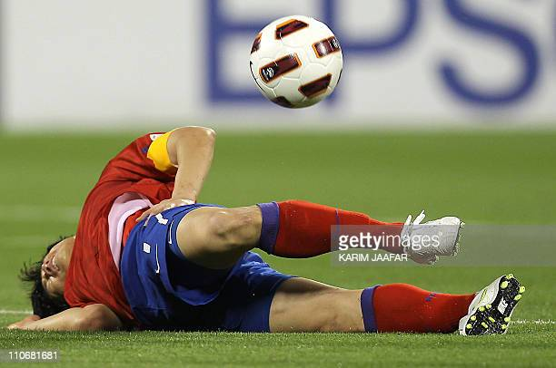 South Korea's midfielder Park Ji-Sung reacts in pain following a challenge during the 2011 Asian Cup group C football match between South Korea and...