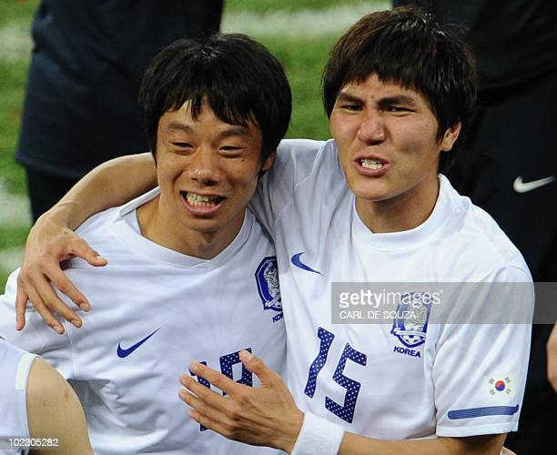 South Korea's midfielder Yeom KiHun and South Korea's defender Kim DongJin celebrate after their Group B first round 2010 World Cup football match on...