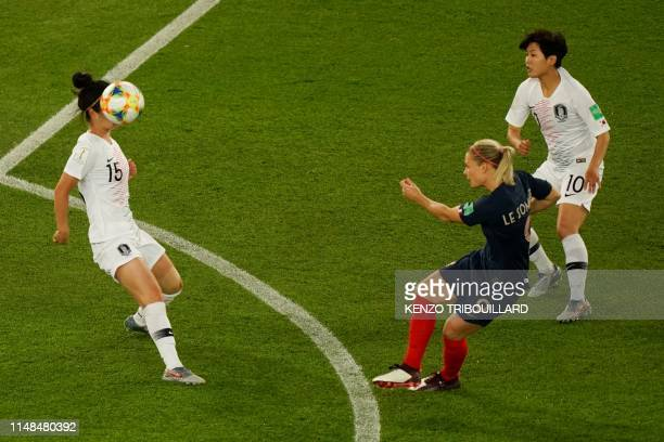 TOPSHOT South Korea's midfielder YoungJu Lee heads the ball next to France's forward Eugenie Le Sommer during the France 2019 Women's World Cup Group...