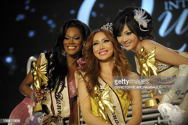 South Korea's Mini celebrates on the stage after she was crowned Miss International Queen 2010 in Pattaya southeastern Thailand late on November 19...