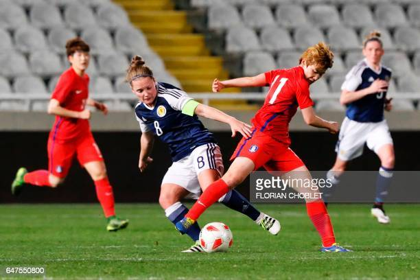 South Korea's Moon Mira fights for the ball against Scotland's Kim Little during the Cyprus Women's Cup football match between South Korea and...
