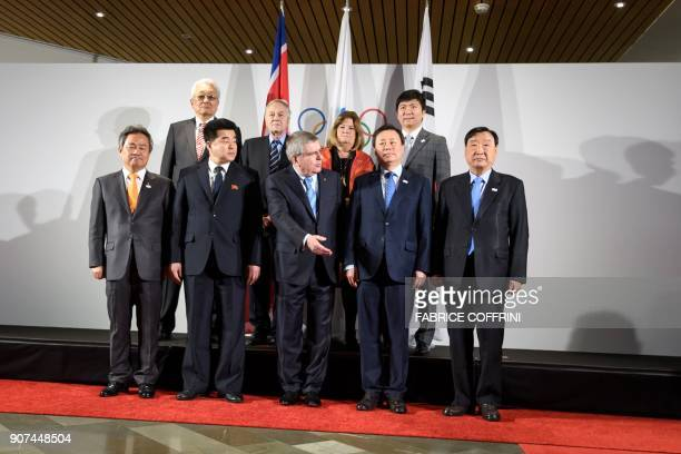 South Korea's National Olympic Committee President Lee Keeheung North Korea's Olympic Committee President and Sports Minister Kim Il Guk German...