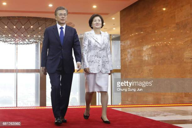South Korea's new President Moon JaeIn and his wife Kim JungSuk arrive for presidential inauguration ceremony at National Assembly on May 10 2017 in...
