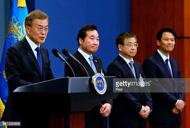 South Korea's new President Moon Jae-In speaks with Prime Minister candidate Lee Nak-Yeon and members of the new cabinet during a press conference at...
