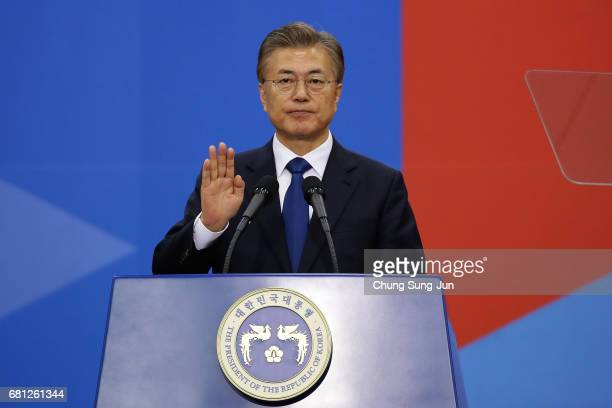South Korea's new President Moon JaeIn takes the oath during his presidential inauguration ceremony at National Assembly on May 10 2017 in Seoul...