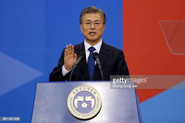 South Korea's new President Moon Jae-In takes the oath during his presidential inauguration ceremony at National Assembly on May 10, 2017 in Seoul,...