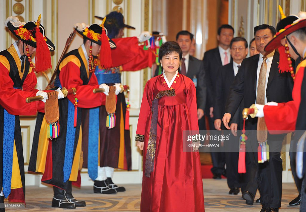 South Korea's new president Park Geun-Hye arrives at the official dinner at the presidential Blue House in Seoul on February 25, 2013. Park Geun-Hye became South Korea's first female president on February 25, vowing zero tolerance with North Korean provocation and demanding Pyongyang 'abandon its nuclear ambitions' immediately.