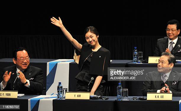 South Korea's Olympic figure skating champion Kim YuNa waves on arrival for Pyeongchang's 2018 Winter Olympic bid presentation in front of the...