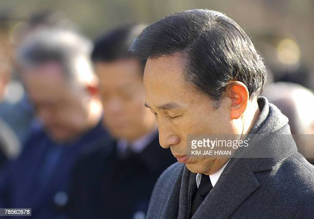 South Korea's opposition Grand National Party presidential candidate Lee MyungBak bows his head in silence to mark the 75th death anniversary of...