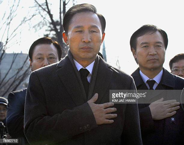 South Korea's opposition Grand National Party presidential candidate Lee MyungBak puts his hand on his heart to mark the 75th death anniversary of...