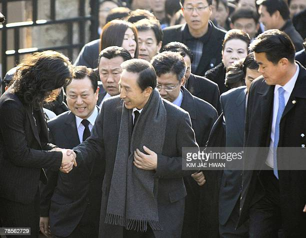South Korea's opposition Grand National Party presidential candidate Lee MyungBak is greets as he visits Dosan park in Seoul to mark the 75th death...