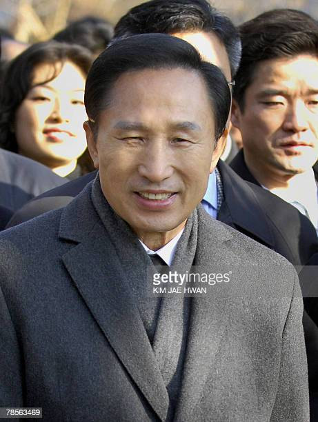 South Korea's opposition Grand National Party presidential candidate Lee MyungBak smiles during a visit to Dosan park in Seoul to mark the 75th death...