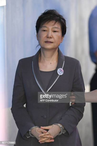 South Korea's ousted president Park Geun-Hye arrives at the Seoul Central District Court in Seoul on August 7, 2017 for her trial over the massive...