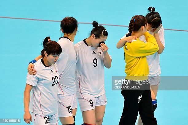 South Korea's player look dejected at the end of the women's bronze medal handball match South Korea vs Spain for the London 2012 Olympics Games on...