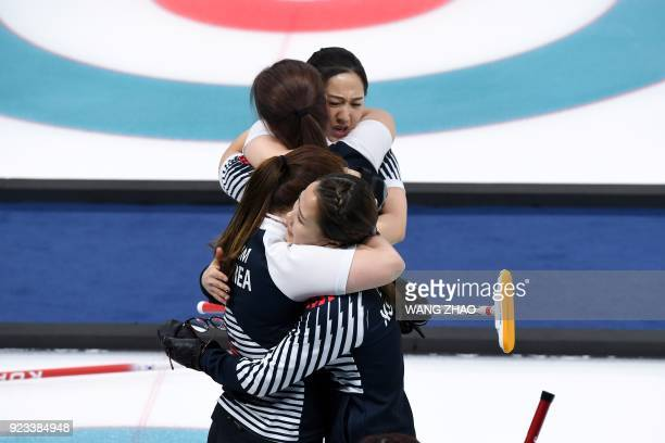 TOPSHOT South Korea's players celebrate after winning the curling women's semifinal game between South Korea and Japan during the Pyeongchang 2018...